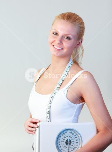 Beautiful woman holding a scales focus on woman