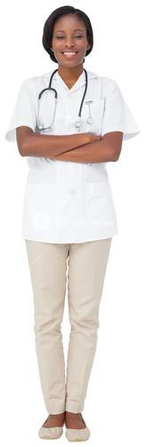 Young nurse in tunic with arms crossed