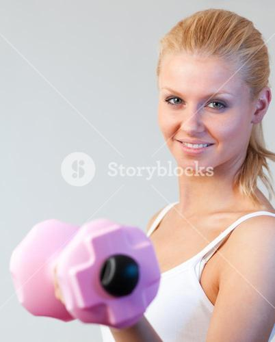 Close up of a friendly woman trained with weights focus on woman