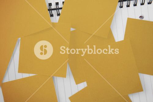 Yellow paper strewn over notepad