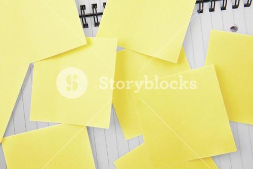 Sticky notes strewn over notepad