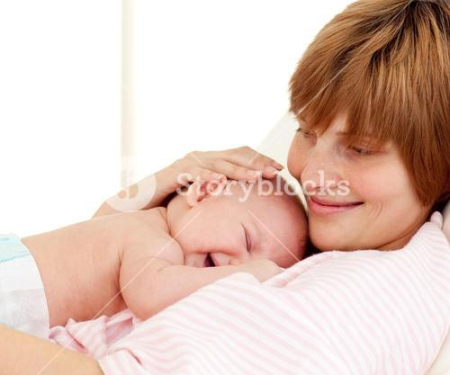 Portrait of a mother holding her newborn baby