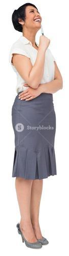 Thoughtful brown haired businesswoman in skirt