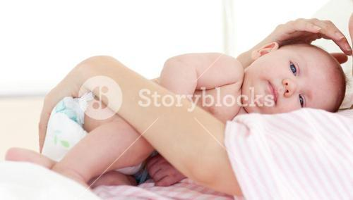 Newborn baby with his mother in bed
