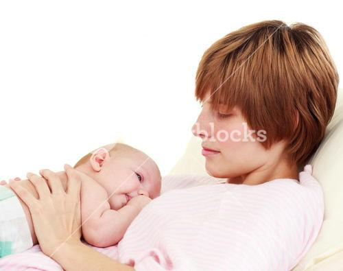 Mother looking at her newborn baby