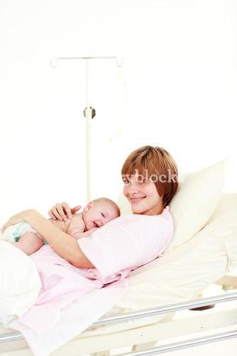 Mother embracing her newborn baby with copyspace