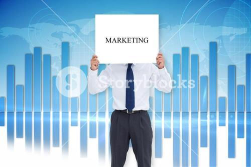 Businessman showing card with the word marketing