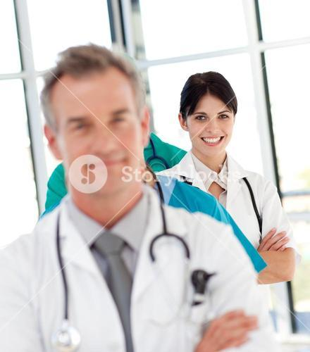 Female doctor in a row smiling at the camera