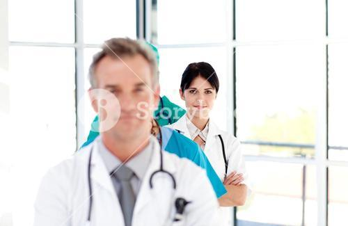 Thoughtful doctor in a row