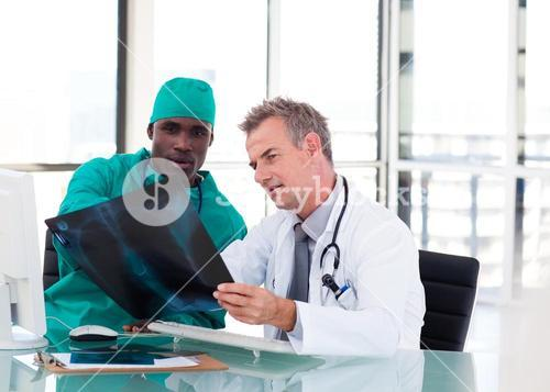 Two doctors talking about two xrays