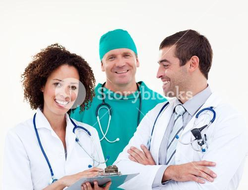 Group of happy doctors looking at the camera
