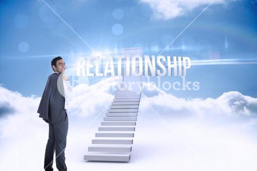 Relationship against shut door at top of stairs in the sky