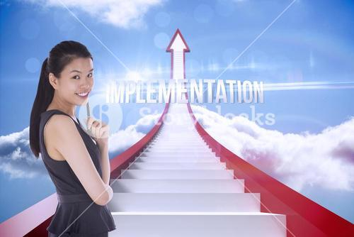 Implementation against red steps arrow pointing up against sky