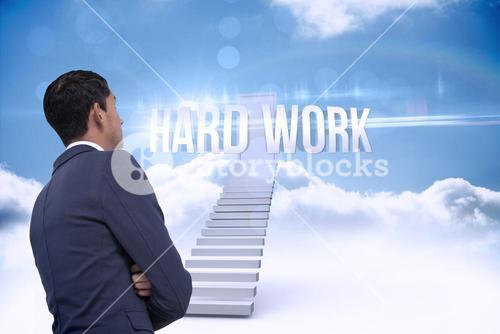 Hard work against shut door at top of stairs in the sky
