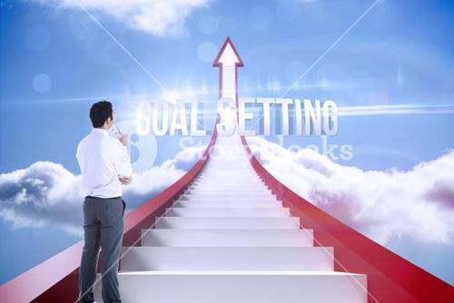 Goal setting against red steps arrow pointing up against sky