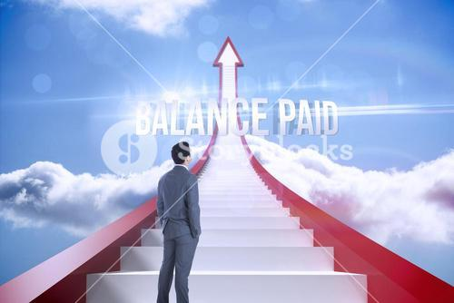 Balance paid against red steps arrow pointing up against sky