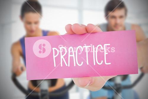 Woman holding pink card saying practice