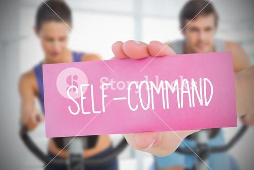 Woman holding pink card saying self command