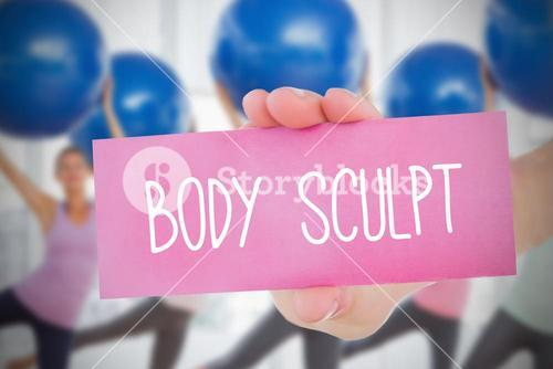 Woman holding pink card saying body sculpt
