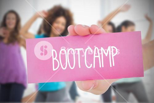 Woman holding pink card saying bootcamp