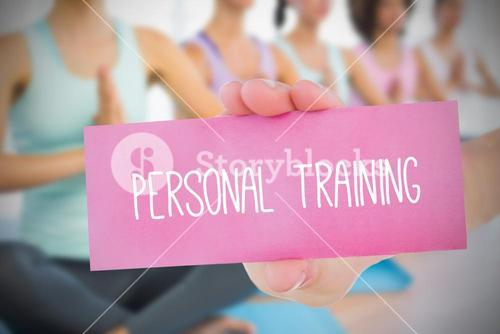 Woman holding pink card saying personal training