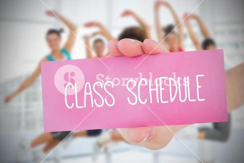 Woman holding pink card saying class schedule