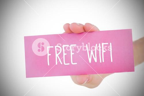 Woman holding pink card saying free wifi
