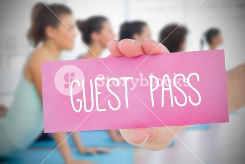 Woman holding pink card saying guest pass
