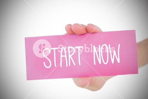 Woman holding pink card saying start now