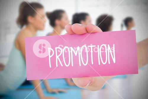 Woman holding pink card saying promotion