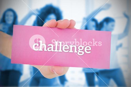 Woman holding pink card saying challenge