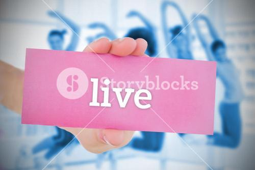 Woman holding pink card saying live