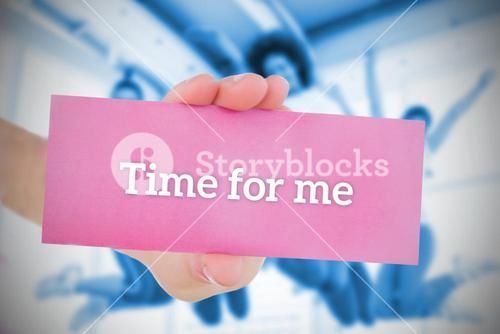 Woman holding pink card saying time for me