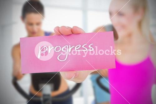 Fit blonde holding card saying progress