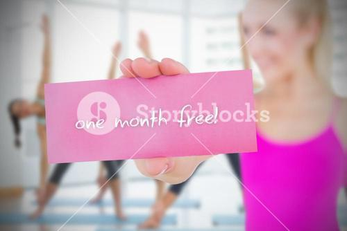 Fit blonde holding card saying one month free