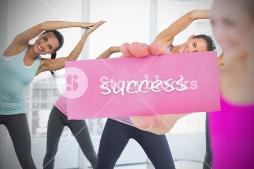 Fit blonde holding card saying success