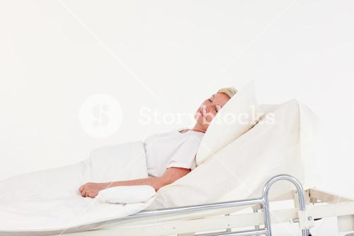 Senior patient lying on a medical bed