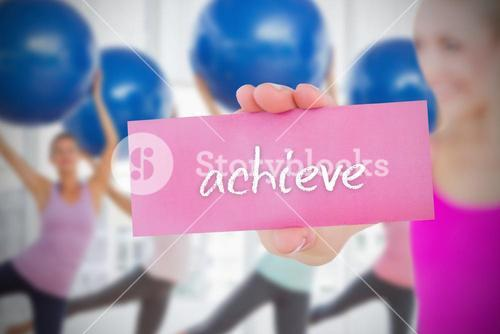 Fit blonde holding card saying achieve