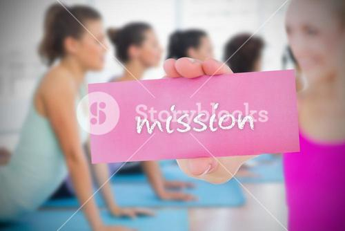 Fit blonde holding card saying mission