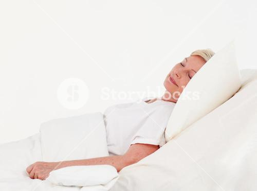 Cute patient lying on a medical bed