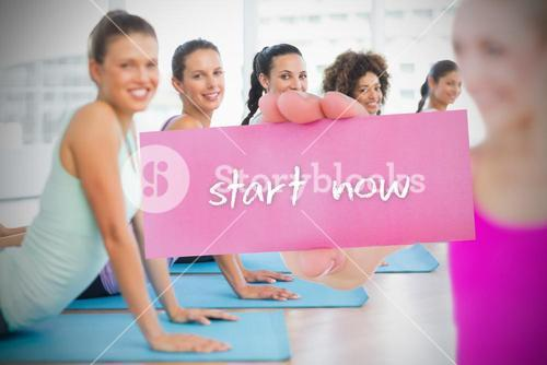 Fit blonde holding card saying start now