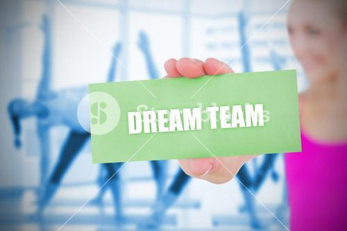 Fit blonde holding card saying dream team