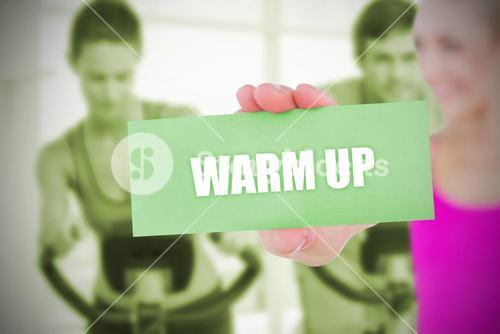 Fit blonde holding card saying warm up