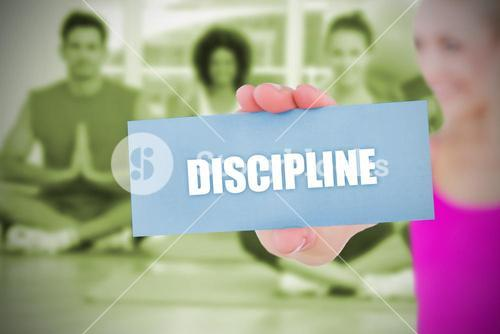 Fit blonde holding card saying discipline