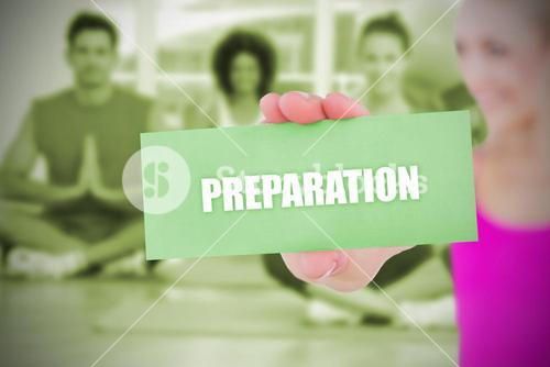 Fit blonde holding card saying preparation