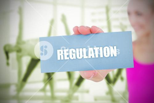 Fit blonde holding card saying regulation
