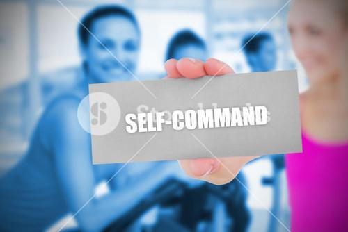 Fit blonde holding card saying self command