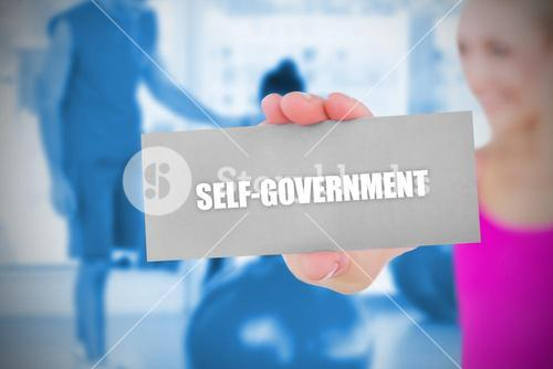 Fit blonde holding card saying self govenment