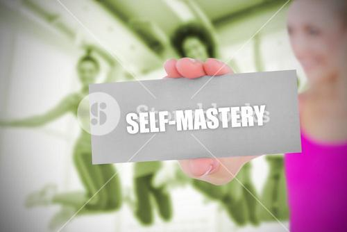 Fit blonde holding card saying self mastery