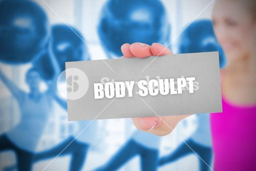 Fit blonde holding card saying body sculpt